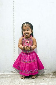 NAGPUR, INDIA - UNSPECIFIED DATE: ***EXCLUSIVE***: Jyoti Amge (15) of Nagpur is the Worlds Smallest Girl according to the Indian Book of Records. She was born on 16th of December 1993) measures just 23.5 inches tall and weighs 5 kg, 250 gm. Jyoti is diagnosed with Achondroplasia; the most recognizable and most common form of dwarfism. Jyoti is a student at the Bhartiya Vidya Niketan Higher Primary School in Nagpur. (Photo by Simon de Trey-White/ Barcroft Media / Getty Images)